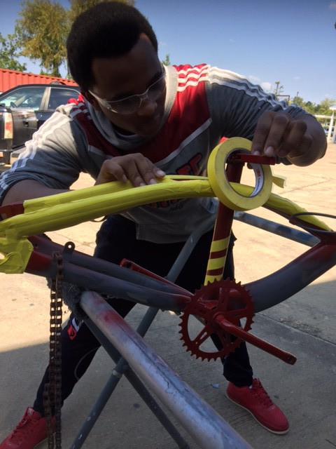 student working on bicycle