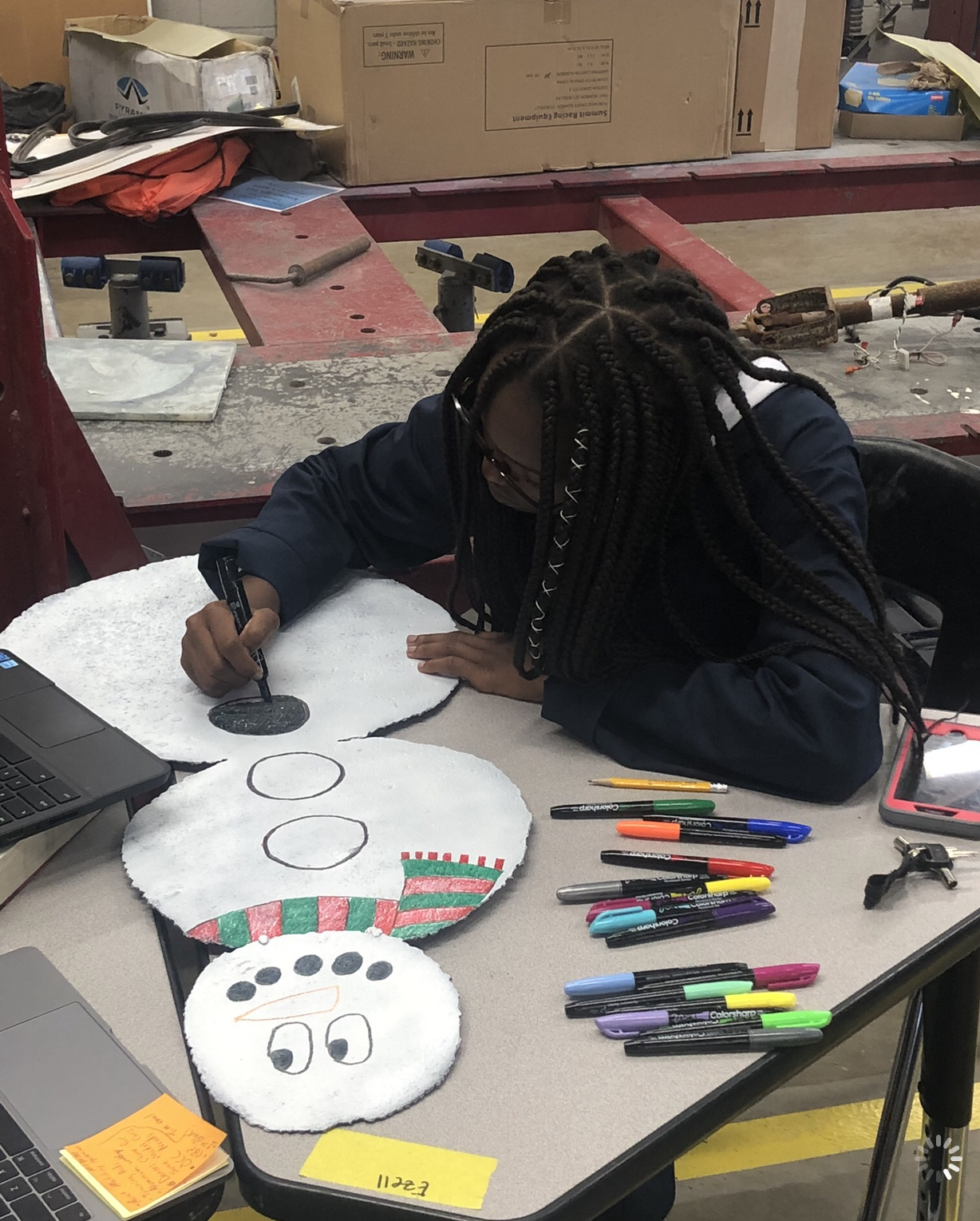 student making float decorations